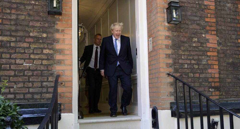 Boris Johnson leaves his campaign headquarters after being elected new leader of the Conservative Party today, in London, Great Britain