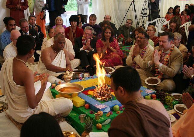 Yajna is a fire deity ritual, common in puja (pooja, Hindu prayers)