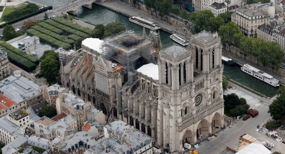 Parts of a destroyed ribbed vault and scaffolding are seen during preliminary work at Notre Dame Cathedral, three months after a major fire ravaged the centuries-old UNESCO World Heritage Site.