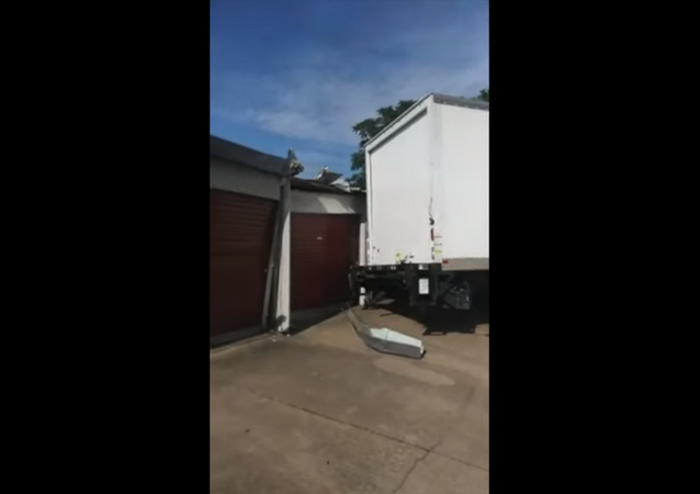 Commercial Truck Smashes Storage Units After Bad Turn
