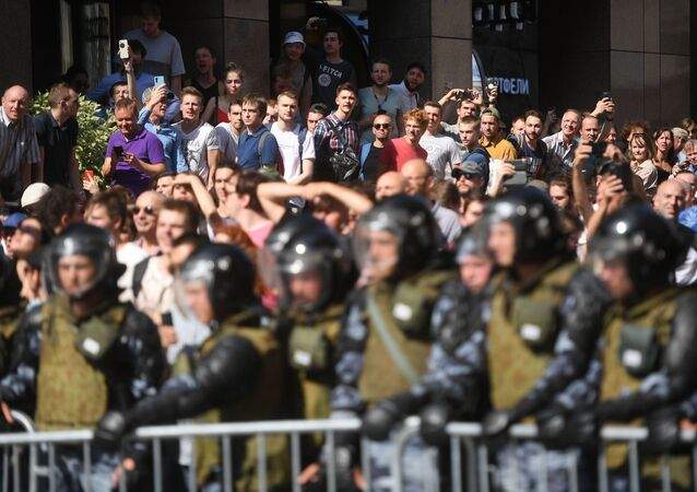 Law enforcement officers block the street next to Moscow's Government building during the rally in support of the registration of independent candidates for the September's elections to the Moscow City Duma, in Moscow, Russia.