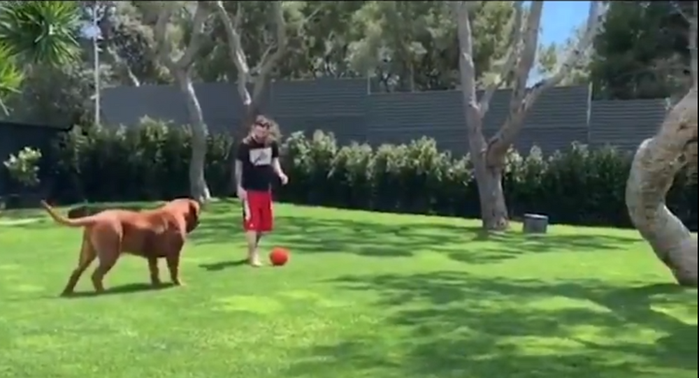 Lionel Messi and his dog