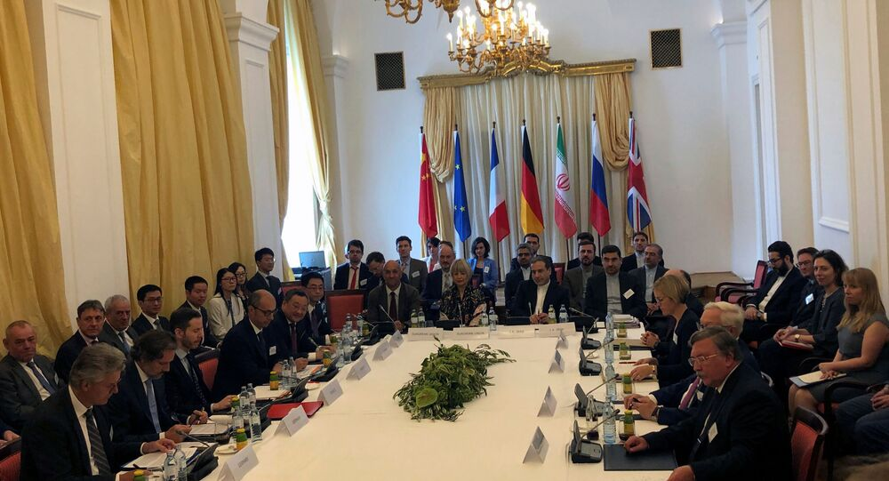 Iran's top nuclear negotiator Abbas Araqchi and EEAS Secretary General Helga Schmid attend a meeting of the JCPOA Joint Commission in Vienna, Austria July 28, 2019