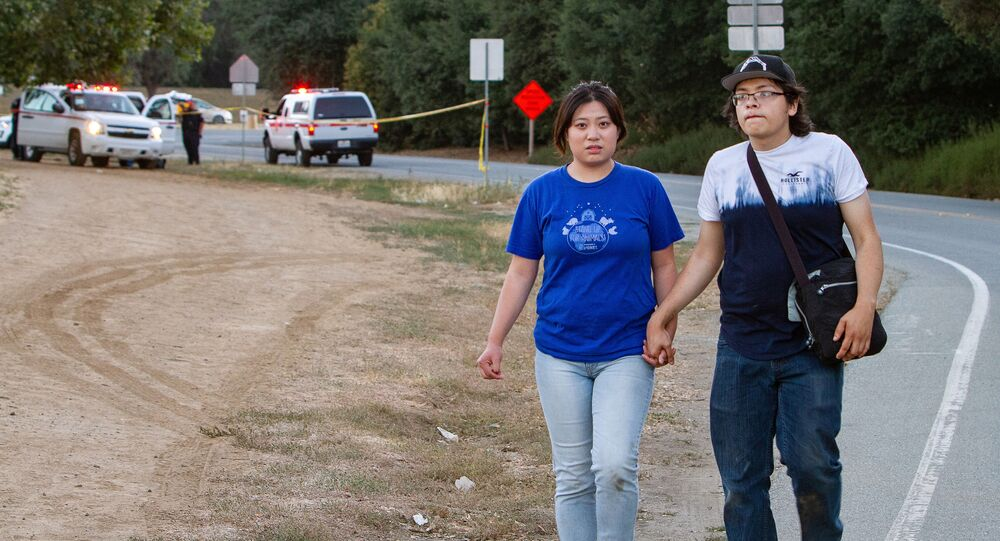 People leave the  scene of a mass shooting during the Gilroy Garlic Festival in Gilroy, California, 28 July 2019.