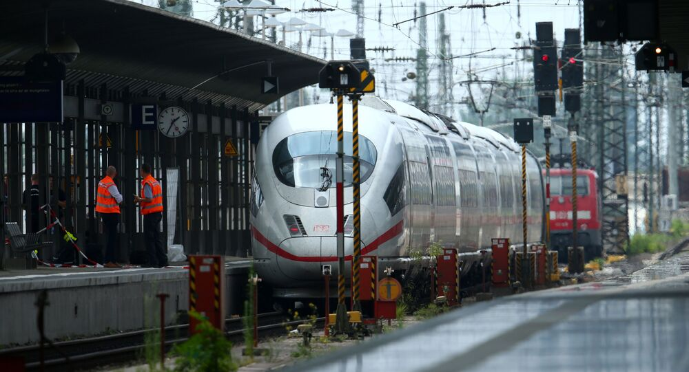 Officials walk on a platform at the main train station in Frankfurt, Germany, July 29, 2019, after a 40-year-old man of African origin pushed an eight-year-old boy in front of an oncoming train, killing him, police said.