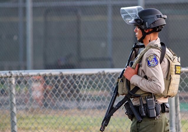 A police officer stands watch at the scene of a mass shooting during the Gilroy Garlic Festival in Gilroy, California, U.S. July 28, 2019.