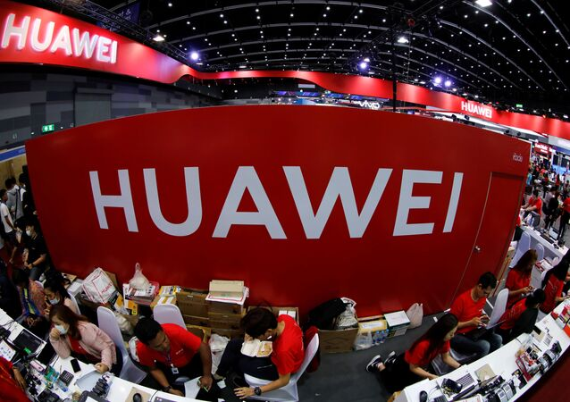 Workers sit at the Huawei stand at the Mobile Expo in Bangkok, Thailand, 31 May 2019