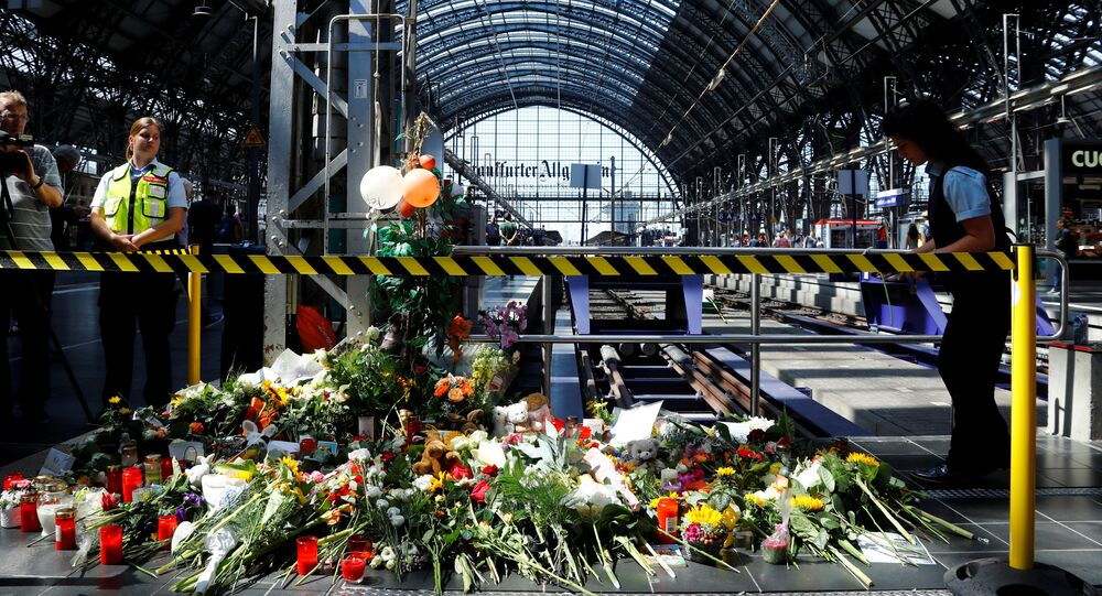 Well-wishers ha left messages of mourning, candles and flowers at Frankfurt's main railway station, where an eight-year-old boy was pushed in front of an oncoming train and died; photo taken 30 July 2019