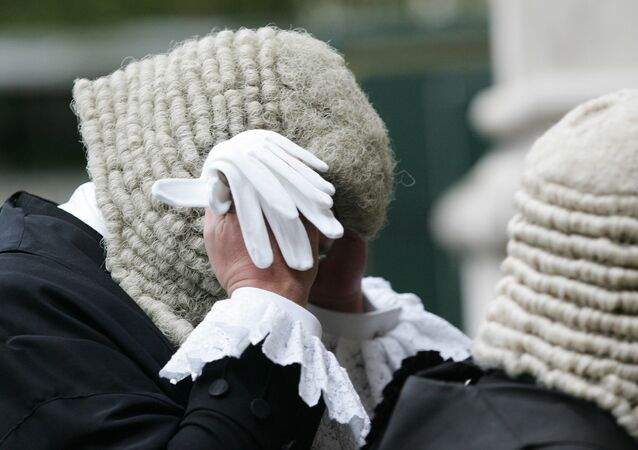 A Judge adjusts his wig as he arrives at  Westminster Abbey at the start of the legal year.