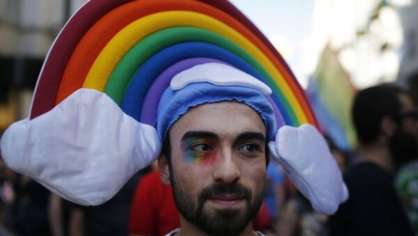 A man participates in the 'Trans Pride' parade in support of Lesbian, Gay, Bisexual and Transsexual LGBT rights, in Istanbul, Turkey, Sunday, June 21, 2015 - Sputnik International