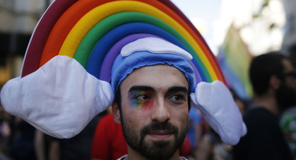 A man participates in the 'Trans Pride' parade in support of Lesbian, Gay, Bisexual and Transsexual LGBT rights, in Istanbul, Turkey, Sunday, June 21, 2015