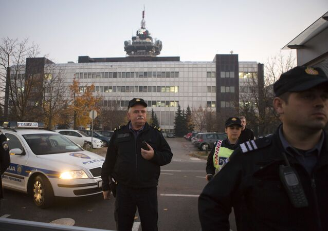 Police secure the building of state TV as members and supporters of of Zivi Zid political party rally in Zagreb, Croatia, Friday, Nov. 6, 2015.