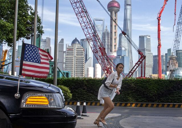 A woman sprints past a U.S. embassy car outside a hotel in Shanghai Tuesday, July 30, 2019. Two months after U.S.-Chinese talks aimed at ending a tariff war broke down, both sides are trying to temper hopes for a breakthrough when negotiations resume Tuesday on an array of disputes that has grown to include tension over China's tech giant Huawei