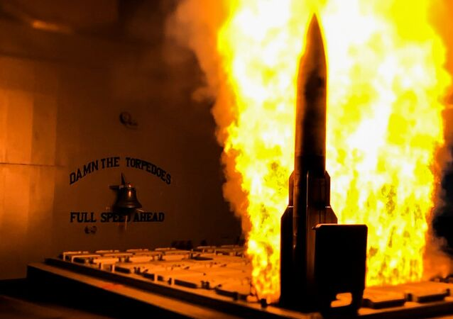 USS Mobile Bay launches an SM-2 missile during live-fire exercise