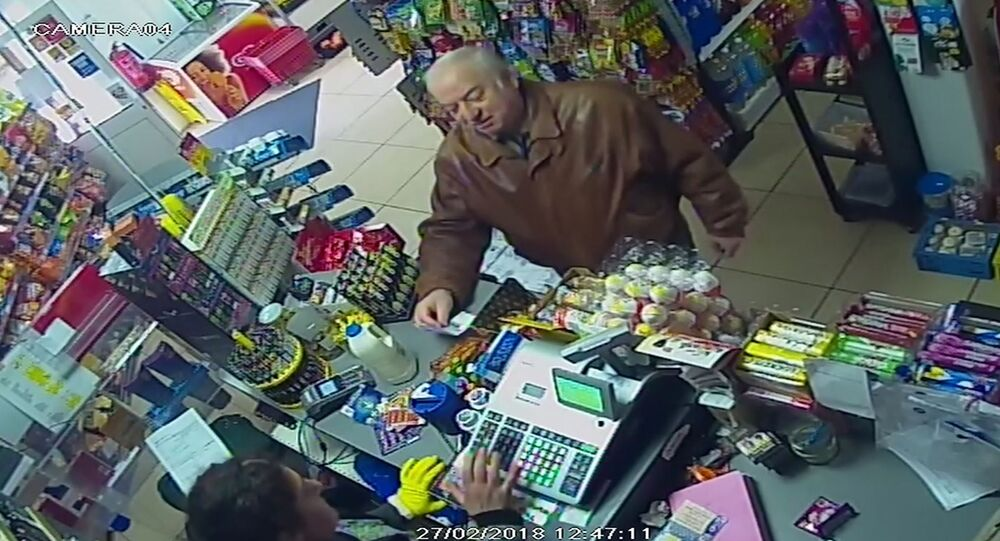 FILE - In this Feb. 27, 2018 file grab taken from CCTV video provided by ITN, former spy Sergei Skripal shops at a store in Salisbury, England