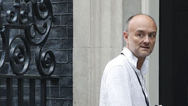Dominic Cummings, a British political strategist and special adviser to Prime Minister Boris Johnson, slinks into 10 Downing Street in London, Tuesday, July 30, 2019. (AP Photo/Alastair Grant) - Sputnik International