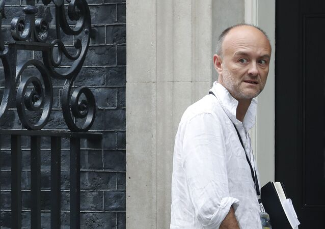 Dominic Cummings, a British political strategist and special adviser to Prime Minister Boris Johnson, slinks into 10 Downing Street in London, Tuesday, 30 July 2019. (AP Photo/Alastair Grant)