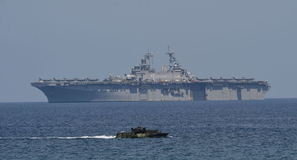 US Marine Amphibious Assault Vehicle (front) maneouvers during the amphibious landing exercises as part of the annual joint US-Philippines military exercise on the shores of San Antonio town, facing the South China sea