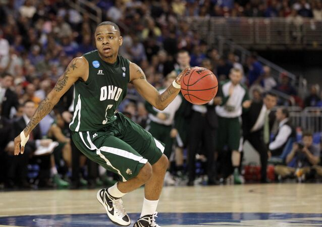Ohio Bobcats' D.J. Cooper dribbles the ball against the North Carolina Tar Heels during the first half of an NCAA tournament Midwest Regional college basketball game Friday, March 23, 2012, in St. Louis.