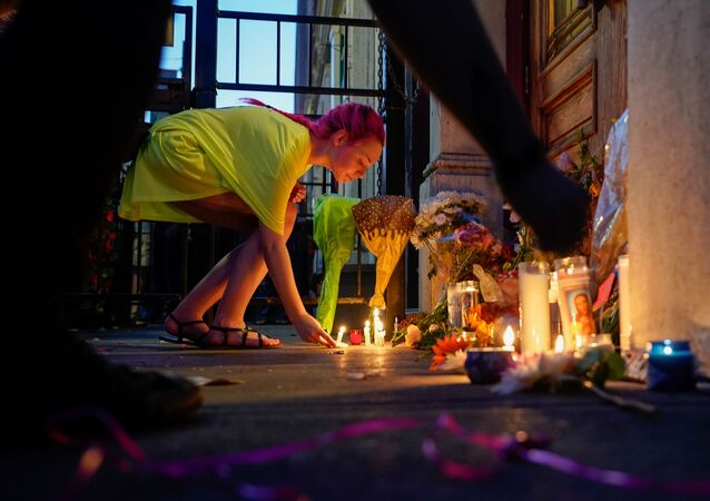 A mourner leaves a candle at the scene of a mass shooting in Dayton, Ohio, U.S. August 4, 2019