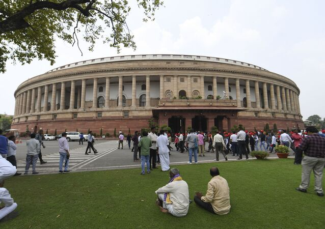 Visitors are seen at the Parliament House in New Delhi on August 5, 2019