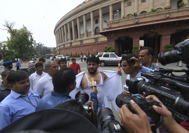 Fayaz Ahmad Mir (C) member of Parliament representing the state of Jammu & Kashmir in Rajya Sabha interact with media at the Parliament house in New Delhi on August 5, 2019