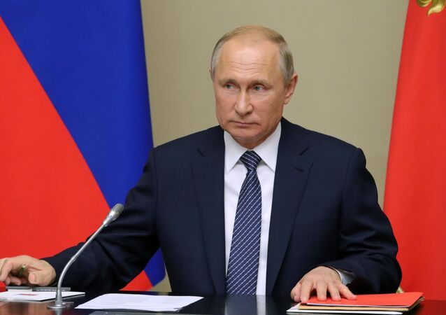 Russian President Vladimir Putin chairs a Security Council meeting at Novo-Ogarevo residence, outside Moscow, Russia