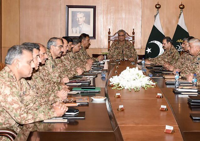 In this handout picture taken and released by Pakistani military Inter Services Public Relations (ISPR) on August 6, 2019, Army Chief General Qamar Javed Bajwa (C) presides over a Corps Commanders' Conference in Rawalpindi.