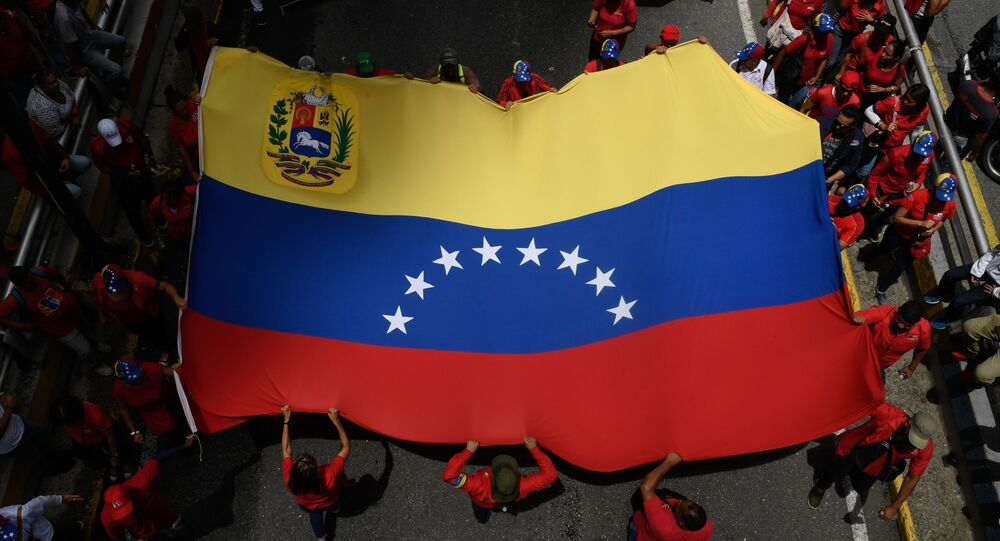 Supporters of Venezuelan President Nicolas Maduro take part in a rally in support of the government and against the recent report on Venezuela by the UN High Commissioner for Human Rights, Chilean Michelle Bachelet, in Caracas, on July 13, 2019