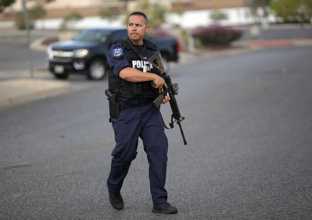 A police officer is seen after a mass shooting at a Walmart in El Paso, Texas, U.S. August 3, 2019.