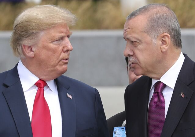 U.S. President Donald Trump, left, talks to Turkish President Recep Tayyip Erdogan, right, as they tour the new NATO headquarters in Brussels, Belgium, Wednesday, July 11, 2018. NATO countries' heads of states and governments gather in Brussels for a two-day meeting.