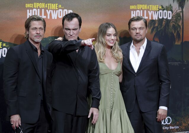 From left, actor Brad Pitt, director Quentin Tarantino, actress Margot Robbie and actor Leonardo DiCaprio pose for the media as they arrive for the Germany premiere of the movie 'Once Upon A Time in Hollywood' in Berlin, Germany, Thursday, Aug. 1, 2019