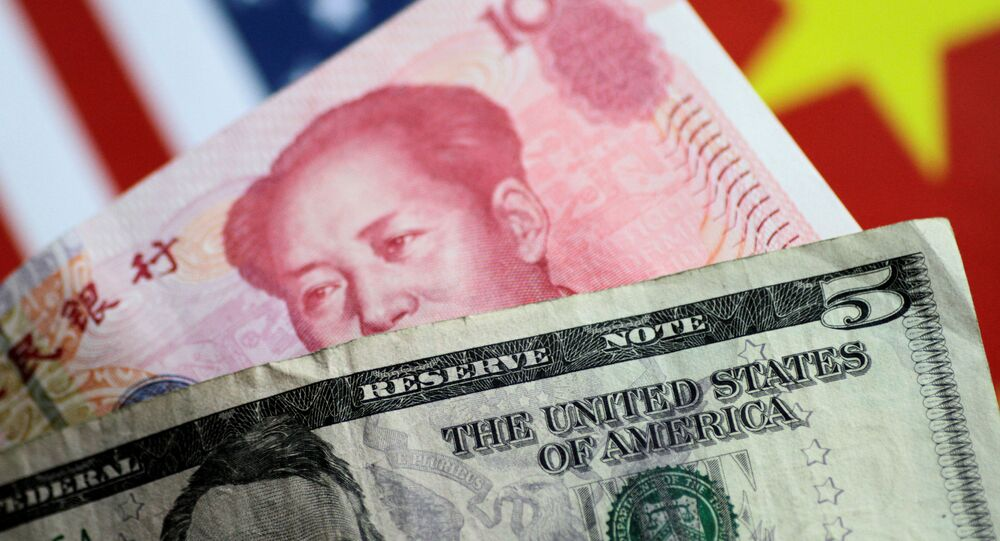 U.S. dollar and Chinese yuan notes are seen in this picture illustration June 2, 2017