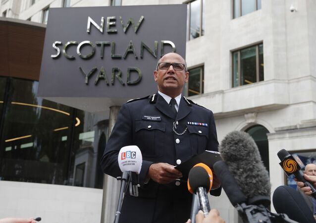 Assistant Commissioner Neil Basu speaks to the media outside New Scotland Yard in London, Tuesday, Aug. 14, 2018