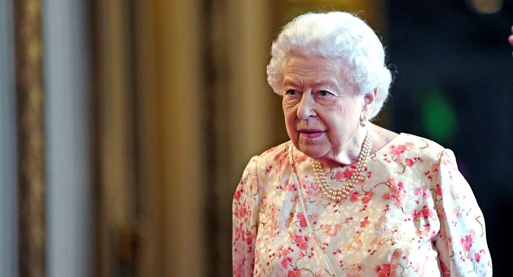 Britain's Queen Elizabeth II views an exhibition to mark the 200th anniversary of the birth of Queen Victoria, for the Summer Opening of Buckingham Palace in London on July 17, 2019