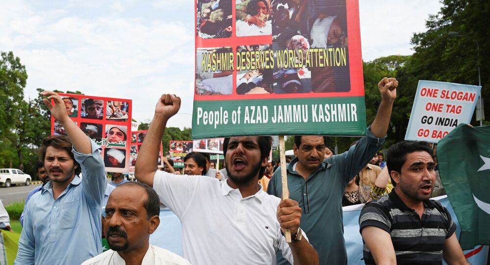 Pakistani Kashmiri people shout anti-Indian slogans during a demonstration in Islamabad on August 7, 2019.