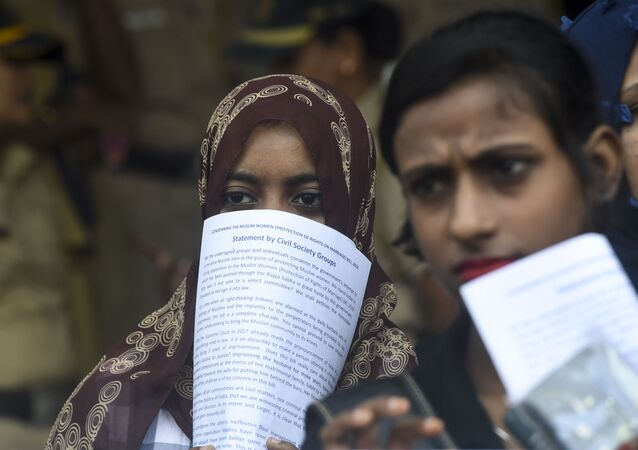 Women take part in a protest against the recent passage of a law to criminalise instant divorce for Muslims in Mumbai on August 1, 2019