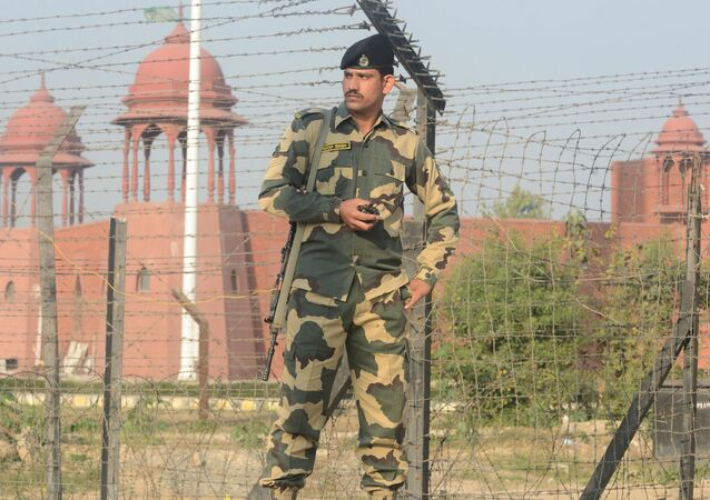 An Indian Border Security Force (BSF) personnel patrol along a fence at the India-Pakistan border, at Wagah some 35kms from Amritsar, on December 18, 2018