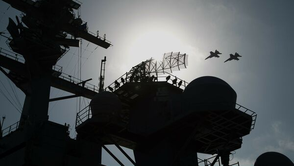 F/A-18 fighter jets fly over the deck of the USS Abraham Lincoln aircraft carrier in the Arabian Sea, Monday, June 3, 2019 - Sputnik International