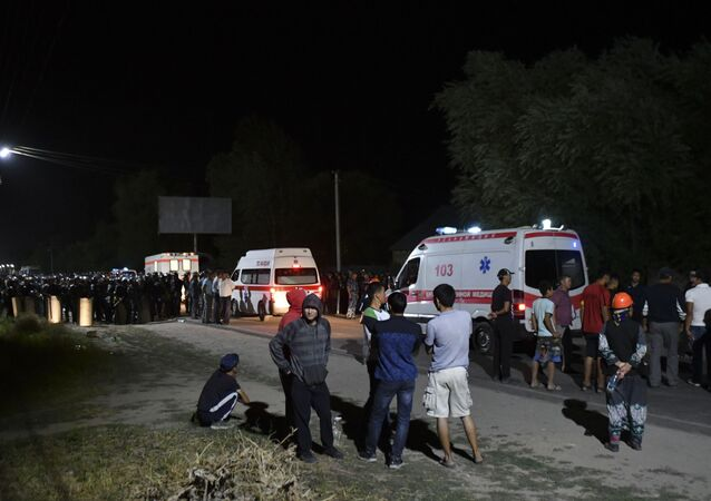 Ambulances stand next to Kyrgyzstan's ex-president Almazbek Atambayev's residence in the village of Koi-Tash, about 20 kilometers (12 miles) south of the capital, Bishkek, Kyrgyzstan, Wednesday, Aug. 7, 2019