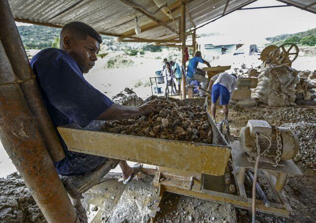 A man works at a stone crusher machine in a gold mine in El Callao, Bolivar state, southeastern Venezuela