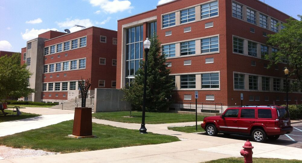 University of Indianapolis building with Jeep Commander in the parking lot