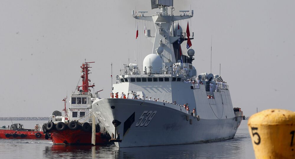 A type 054A guided missile frigate Wuhu, prepares to dock at Manila's South Harbor for a four-day port call Thursday, Jan. 17, 2019 in Manila, Philippines