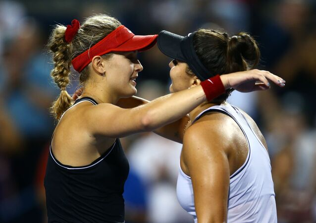 TORONTO, ON - AUGUST 06: Bianca Andreescu (R) of Canada hugs Eugenie Bouchard of Canada following her victory over Bouchard in a first round match on Day 4 of the Rogers Cup at Aviva Centre on August 06, 2019 in Toronto, Canada