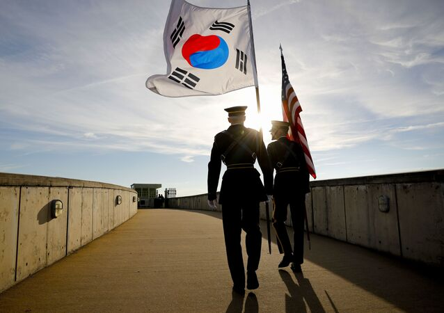 Members of the Honor Guard carry U.S. and South Korea flags after participating in the 2018 Security Consultative at the Pentagon, co-hosted by Defense Secretary Jim Mattis and South Korea Minister of Defense Jeong Kyeong-doo, Wednesday, Oct. 31, 2018