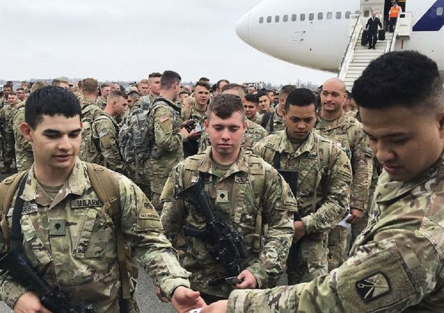 Soldiers from the 1st Armored Division, based in Fort Bliss, Texas, arrives at the airport Tegel in Berlin, Thursday, March 21, 2019