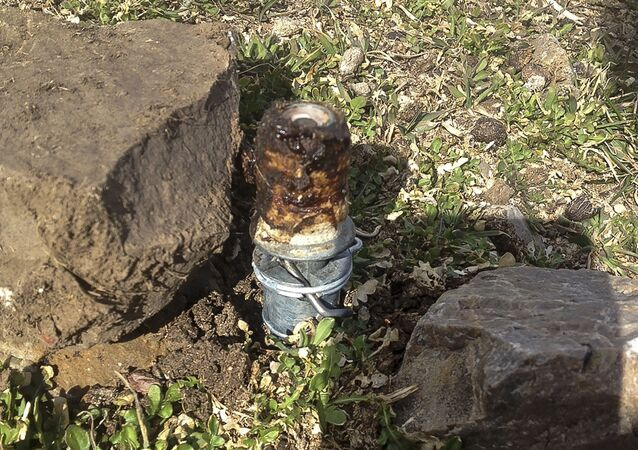 This March 16, 2017, file photo released by the Bannock County Sheriff's Office shows a cyanide device in Pocatello, Idaho, The cyanide device, called M-44, is spring-activated and shoots poison that is meant to kill predators. The U.S. Environmental Protection Agency has taken an initial step to reauthorize a predator-killing poison that injured a boy in eastern Idaho and killed his dog. The federal agency on Tuesday, Aug. 6, 2019, announced an interim decision involving sodium cyanide that's used in M-44s.