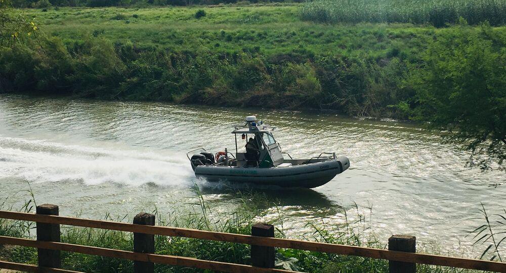 A U.S. Border Patrol boat navigates the Rio Grande
