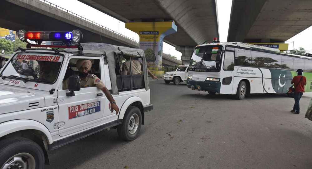 Punjab Police escort a Pakistan Tourism Development Corporation bus as it returns to Lahore without passengers, in Amritsar, India, Saturday, Aug. 10, 2019.