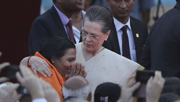 United Progressive Alliance chairperson Sonia Gandhi, center, hugs Bharatiya Janata Party leader Uma Bharati at the swearing in ceremony of Indian prime minister Narendra Modi and his cabinet at the forecourt of presidential palace in New Delhi, India, Thursday, May 30, 2019. - Sputnik International